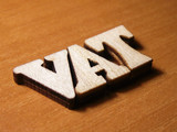 The word vat written with wooden letters background