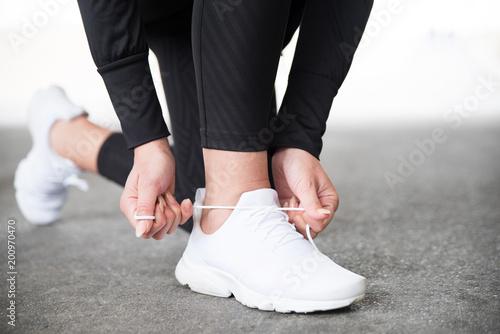 Keuken foto achterwand Jogging Sport, Schuhe binden