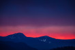 peak of mountains with red sunset and stormy weather backgrounds