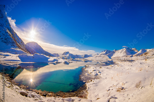 Outdoor view of amazing nature landscape with turquoise water and sunny day in blue sky in Svolvaer