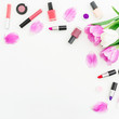 Leinwanddruck Bild Beauty composition with pink tulips bouquet and cosmetics on white background. Top view. Flat lay feminine desk.