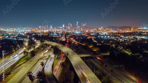 Wall mural Aerial time lapse of 5, 101 and 60 freeways traffic and Downtown Los Angeles on the background at night