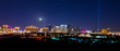A view of the Las Vegas skyline with a full moon shining down.