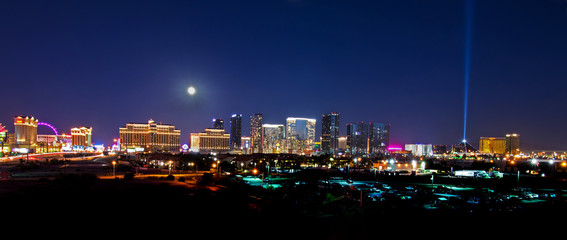 A view of the Las Vegas skyline with a full moon shining down. © Jenelle