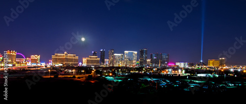 A view of the Las Vegas skyline with a full moon shining down. - 201013051