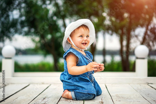 Pretty little baby girl playing outdoor