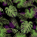 Dark seamless pattern with leaves of palm trees