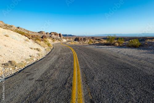 Plexiglas Route 66 Long winding road through the Mojave desert.