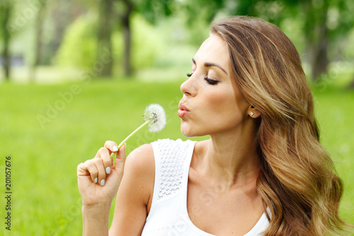 beautiful young woman with dandelion - 201057676