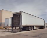Heavy goods truck at loading depot facility