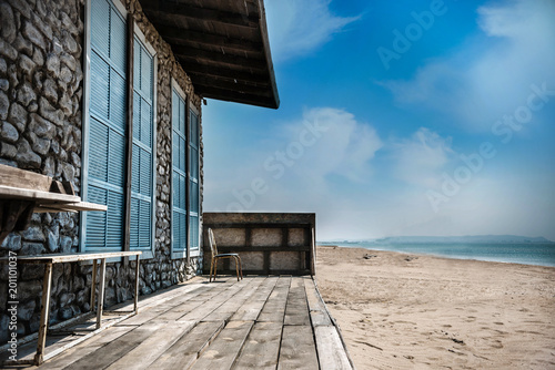 Plexiglas Zomer abandoned house on the beach