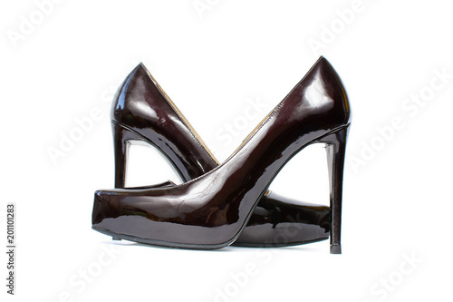 d6f4d25568f Lacquered black sexy shoes with high heels isolated on white. Women classic  varnished shoes close