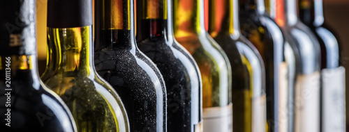 Line of wine bottles. Close-up. - 201113466