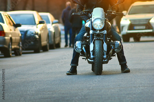 Biker hooligan stopped motorcycle in the middle of the road