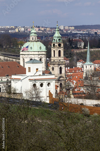 Foto Murales View on the sunny spring Prague with St. Nicholas' Cathedral, Czech Republic