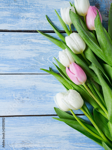 white tulips on wooden surface