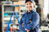Smiling mechanic portrait - 201124699