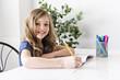 child girl doing homework at home kitchen table
