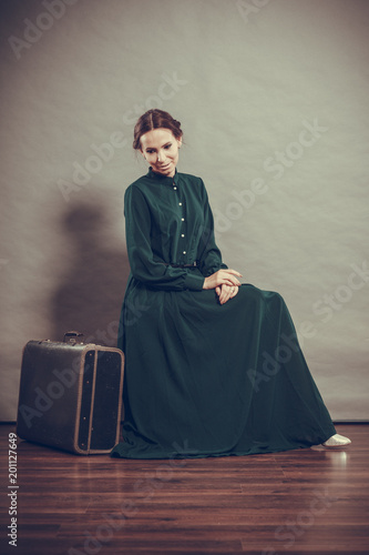 Woman retro style with old suitcase