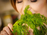 Young woman holding dill herb - 201128010
