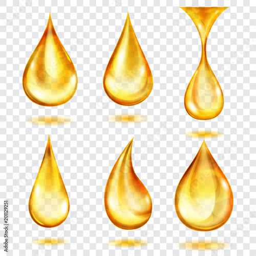 Set of translucent drops in yellow colors, isolated on transparent background. Transparency only in vector format