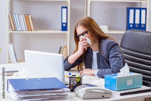 Businesswoman employee sick in the office