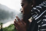 Woman enjoying morning coffee in nature
