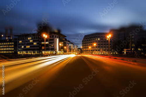 Fotobehang Berlijn Light trails on the Jannowitz bridge at the Blue Hour,creatively edited with tilt / shift effect