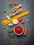 Italian food and menu concept. Spaghetti with ingredients sweet basil ,tomato ,garlic peppercorn and champignon on dark background flat lay and copy space. - 201145644