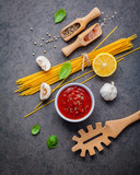 Italian food and menu concept. Spaghetti with ingredients sweet basil ,tomato ,garlic peppercorn and champignon on dark background flat lay and copy space. - 201145820