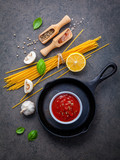 Italian food and menu concept. Spaghetti with ingredients sweet basil ,tomato ,garlic peppercorn and champignon on dark background flat lay and copy space. - 201145871