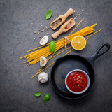 Italian food and menu concept. Spaghetti with ingredients sweet basil ,tomato ,garlic peppercorn and champignon on dark background flat lay and copy space. - 201145877