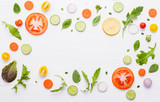 Food pattern with raw ingredients of salad, lettuce leaves, cucumbers, tomatoes, carrots, broccoli, basil ,onion and lemon flat lay on white wooden background. - 201146015