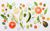 Food pattern with raw ingredients of salad. Various vegetables lettuce leaves, cucumbers, tomatoes, carrots, broccoli, basil ,onion and lemon flat lay on white wooden background. - 201146041