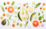 Food pattern with raw ingredients of salad, lettuce leaves, cucumbers, tomatoes, carrots, broccoli, basil ,onion and lemon flat lay on white wooden background. - 201146042