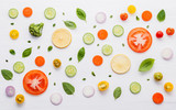 Food pattern with raw ingredients of salad, lettuce leaves, cucumbers, tomatoes, carrots, broccoli, basil ,onion and lemon flat lay on white wooden background. - 201146055