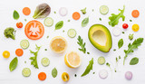Food pattern with raw ingredients of salad, lettuce leaves, cucumbers, tomatoes, carrots, broccoli, basil ,onion and lemon flat lay on white wooden background. - 201146061
