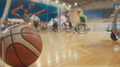 Fotobehang Bol Ball of basketball during training for disabled wheelchair sportsmen