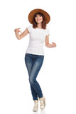 Beautiful Smiling Woman In Brown Hat Is Pointing At Her White T-shirt - 201164042
