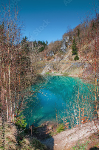Beautiful blue mountain lake. The Blue Colour is caused by former limestone mining. (Blauer See, Hüttenrode near Blankenburg, National Park Harz in Germany - 201170687