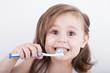 Leinwanddruck Bild - Cute little girl brushing her teeth