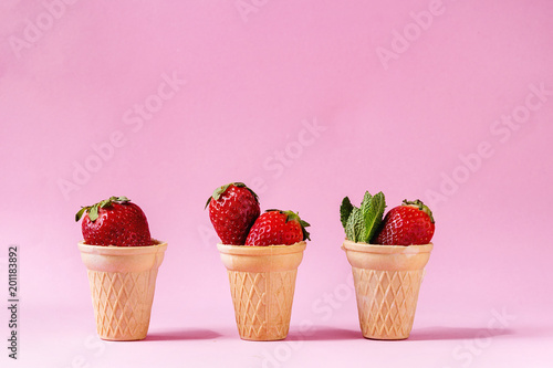 Fresh strawberries in waffle cups over pink pastel pin-up background. Copy space. - 201183892