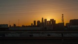 Downtown Los Angeles at sunset. Sun shines between buildings. 4K time lapse - 201187673