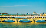 Metro train on the Pont de Bercy, a bridge over the Seine in Paris, France