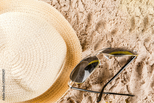 Summer vacation concept, bright yellow background with hat, sun glasses