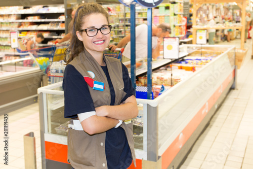 a girl employed at the checkout of the store supermarket