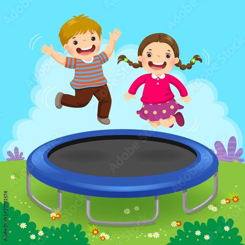 Happy kids jumping on trampoline in the backyard