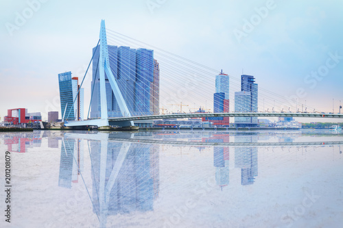 Fotobehang Rotterdam Erasmus bridge across new meuse, luxor theatre, headquaters of KPN, Montevideo, port center of Rotterdam