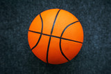 Basketball ball on dark surface
