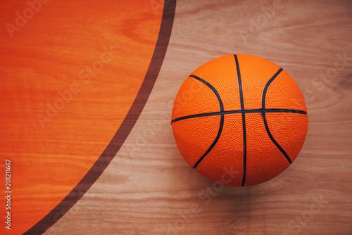 Fotobehang Basketbal Basketball ball on court floor